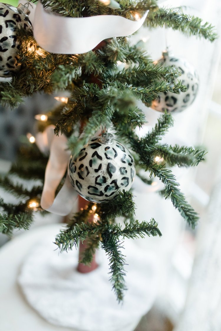 black and white tabletop christmas tree, leopard print ornaments, holiday home decor